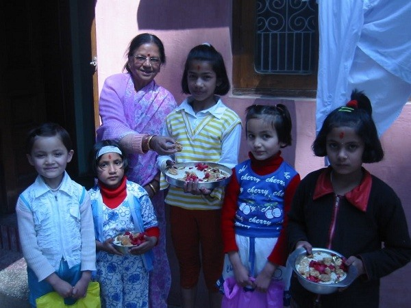 Kids Celebrating Phool Dei Festival